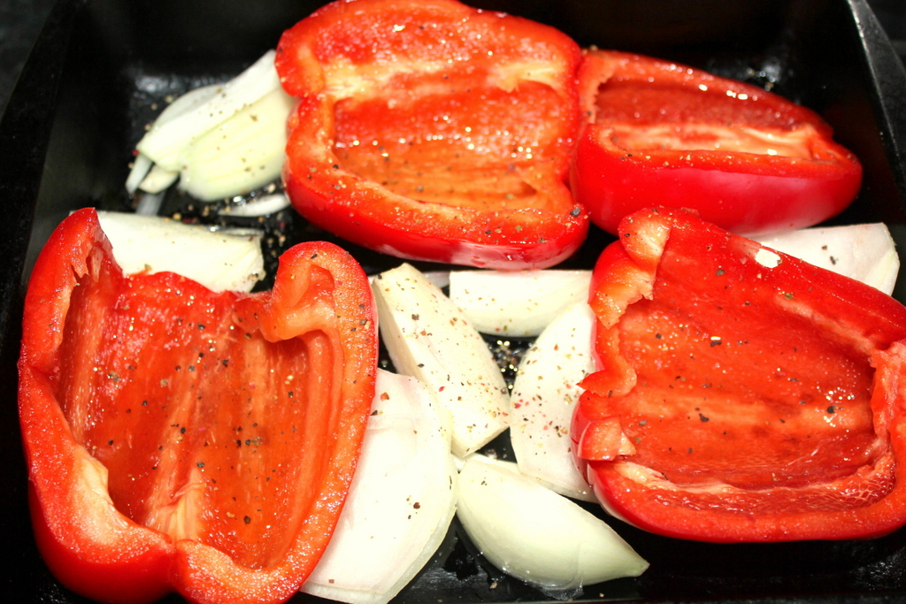 Cooking red peppers and onion